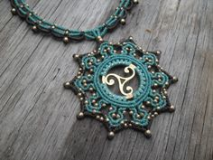 The power of theTrisquel crimped in this mandala macrame necklace ... made whit resistant waxed thread and brass beads....  Trisquel is a Celtic symbol representing the past, present and future, and also the balance between body, mind and spirit.....