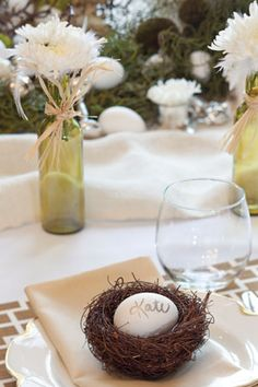 Delight guests by decorating individual place settings with a small bird's nest. Use an egg for a creative twist on a place card. To download the printables used in this party package Click on the Picture