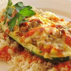 I've been looking for more zucchini recipes and this one looks yummy! Sausage stuffed Zucchini