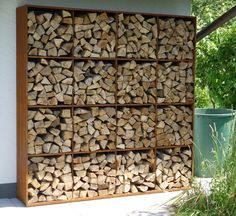 Create a feature wall of wood, outdoors. For a rustic vibe made modern organise in a symmetrical pattern Get more design inspiration and tips by subscribing at www.gildedattics.com