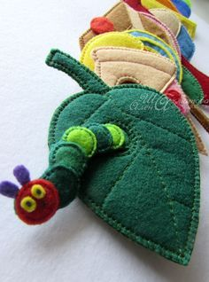 """NFS idea based on book """"The Very Hungry Caterpillar"""". Hand sewn felt pc's can ea be strung a green satin ribbon attached to the caterpillar. Diy Quiet Books, Baby Quiet Book, Felt Quiet Books, Sewing Toys, Sewing Crafts, Sewing Projects, Baby Crafts, Felt Crafts, Chenille Affamée"""