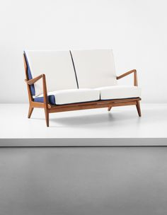 GIO PONTI Settee, model no. 516, 1950s  Walnut, fabric. 31 x 53 x 29 3/8 in. (78.7 x 134.6 x 74.6 cm) Manufactured by Cassina, Italy. Together with a certificate of authenticity from the Gio Ponti Archives.