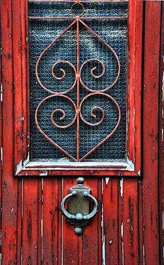 Crete, Greece Wine colored door on the island of Crete, Greece  Photo by: gwoggie