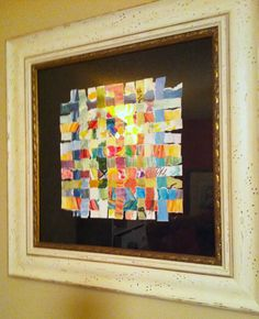 woven watercolor blessing- guests paint their own pictures and then they get torn and woven to create this piece of art for the baby's room