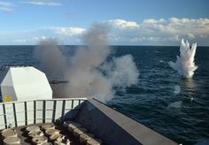 """The mighty 4.5"""" gun of HMS Iron Duke pounded waves off Dorset,proving she remains a fighting force,ready for operations around globe. Practice firings test both weapons system itself & abilities of 'Gunners' to use it correctly,practicing drills & skills.In UK waters,safe firings paramount importance & safety features highly in firing procedures."""