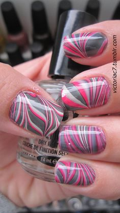 Pink and grey water marble nails. Just pour polish in water, wait until they mix the way you want at the surface and dip your nails in.