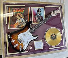 Bob Marley Signed Guitar with Bio, Photo and Album
