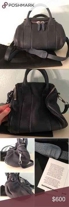 Alexander Wang Heat Sensitive Rockie Bag Dark blue leather changes to light blue with heat/touch. Gradually returns back to dark color. Shown in last photo. Last photo is best showing of actual color. Called Poseidon/Galaxy. Dust bag. Silver hardware. Black/silver rivets on bottom. Zip top. Interior has zipper pocket & 2 open pockets. One side has 2 zipper pockets (outside). Used & shows wear. Scratches, marks, color coming off in spots. Small tab attached to bag where long strap is attached…