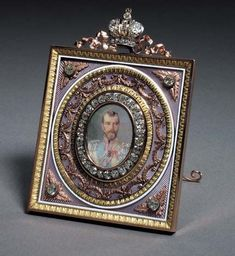 A highly important jewelled three-color gold and guilloché enamel Imperial Presentation Frame marked Fabergé, workmaster Henrik Wigström, St. Petersburg, 1896-1908 diamond bezel enclosing a portrait miniature by Zuev depicting Tsar Nicholas II