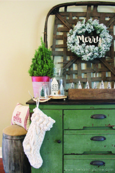 Rustic Traditional Christmas Console Table with tobacco basket, knit stockings and sugar mold