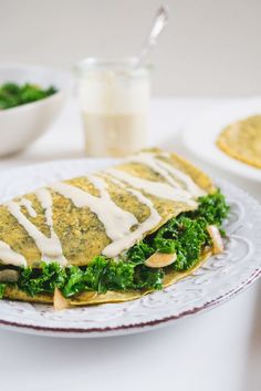 """Do you feel stuck with your current vegan breakfast options? Or maybe your mornings used to start with a rich and fluffy omelet that you really miss having on your plant-based diet. Well, it turns out that even omelet can be veganized. So today I'll share one of my most favorite breakfast recipes – satisfying vegan omelet with kale filling and cheesy tahini sauce. I know, the word combo """"vegan omelet"""" sounds quite bizarre. After all, you need eggs to make an omelet, right? Of course, you…"""