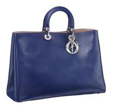 Information on the Diorissimo Tote bag by Christian Dior. This style  features a stiff top handle (similar to the Lady Dior) but has a soft  leather base 04d90d33b64cb