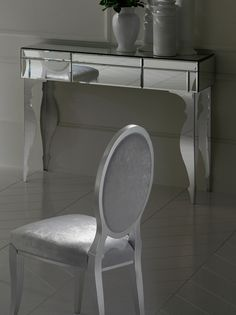 The Diva Collection mirrored console with central drawer and polished steel baroque legs is the perfect addition to any dining room, adding a touch of glamour!