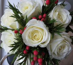 Rosa 'Avalanche' in wedding bouquet made by Anthea three days after Christmas, along with Hypericum berries and Callistemon foliage. http://www.dyg.ie/garden-blog/january-our-shop-lots-bloom-and-looking-good
