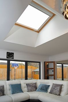 Never ending light here! It brightens up this lovely living room with views of the clear skies and the garden. #livingroom #roofwindows #homedesigns #windows #homeliving