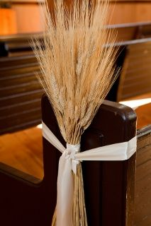 wheat on church aisle adds fall touch to wedding decor
