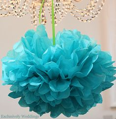 This is a tutorial on how to make tissue paper pompoms which look just fabulous strung from trees or from the ceiling at your wedding venue (even prettier when combined with fairy lights - well what isn't?). They are an easy way to add some real wow to your wedding decor without blowing your budget.