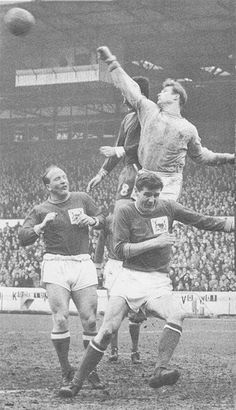 12th April 1966. Chelsea inside forward Bert Murray challenging Nottingham Forest goalkeeper Peter Grummitt and team mate Jeff Whitefoot and Bob McKinley, at the City Ground
