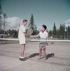 Grant Moore and Alex Groetaers shake hands on tennis courts at Waskesin, Prince Albert National Park, Saskatchewan, 1952. #vintage #sports #Tennis #Canada #1950s