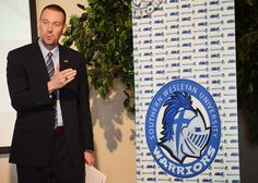 Southern Wesleyan University Athletic Director Chris Williams unveils a new logo for the Warriors during a news conference Jan. 23 at the Central campus. According to Williams, the helmet signifies strength and character, as well as the university's Christ-centered focus. http://www.swu.edu/about-swu/news/southern-wesleyan-university-unveils-athletic-logo/