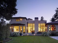 Exterior Photos Spanish Bungalow with industrial floor to ceiling windows to back yard