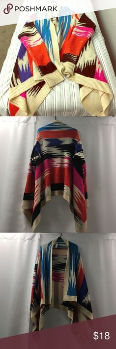 Forever 21 multi-color sweater! Size Large! Size Large, forever 21 multi-color sweater. Sweater is a khaki color with black, pink, orange, blue, teal colors theoughout. Very thick very warm, I love this but it is a little big in the shoulder area since I am a Medium through and through. Forever 21 Sweaters Shrugs & Ponchos