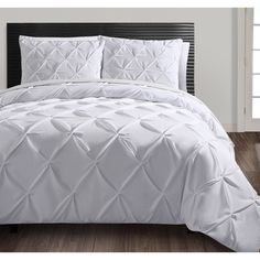 This contemporary duvet cover set is available in the choice of several colors. Featuring a diamond design and button closure, the woven polyester set includes one duvet cover and a pair of standard pillow shams. Shams available as separate option.