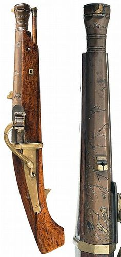 Japanese matchlock pistol,  bronze barrel deeply engraved with golden and silver inlays of flying birds, grass, and a pattern in the shape of a birds foot on the right side at the breech with golden post front and notch rear sights and small round silver and gold inlays. The smooth lockplate, band at the breech, trigger, and floral side pieces are brass. It is all mounted on a smooth hardwood stock and includes a wooden ramrod with brass tip, 17in.