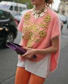 Gold frogging on angora sweater. Orange stretch pant. Violet clutch.