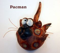 Rakued with Pacman Glaze. fish line whiskers. Hangers and sitters available. Raku Pottery, Pottery Sculpture, Fish Ornaments, Christmas Ornaments, Rockhopper Penguin, Clay Cats, Baby Turtles, Little Fish, Baby Dragon