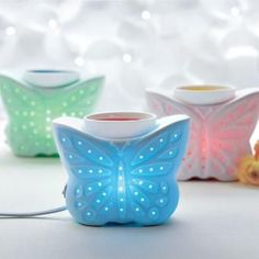This is another awesome electric warmer for a kids room. The color changing relax's them to fall asleep. Butterfly ColorGlo ScentGlow® Warmer: Whimsical butterfly shimmers in shades of the rainbow. Electric porcelain warmer continually rotates through a range of colors while releasing the fragrance of PartyLite Scent Plus® Melts.  www.partylite.biz... #children #kids #adults #electric warmer #partylite