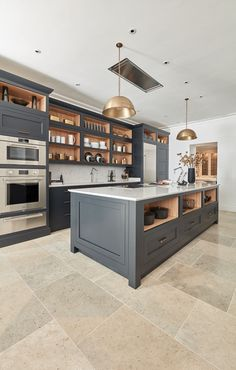 This impeccable dark grey shaker style kitchen brings a classic concept bang up to date. The hand-painted finish echoes the quality and craftsmanship that has gone into every inch of the design and build.