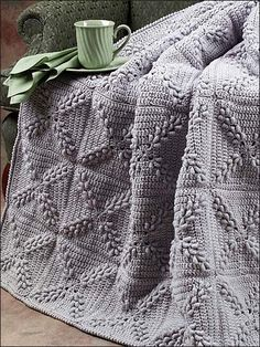 Love the design of this afghan, pattern can be purchased