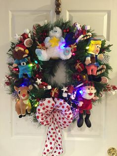 Amazing Rudolph the Red-Nosed Reindeer wreath. Approximately 30 inches wide x 36 inches from the top of wreath to the tail of the bow and 6