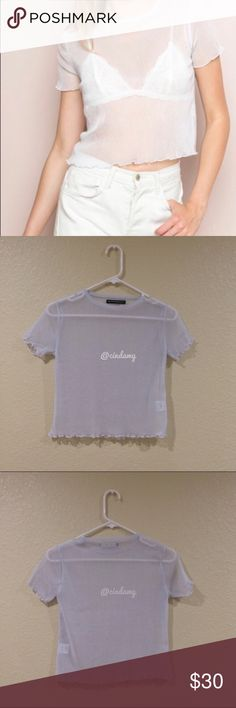 "Brandy Melville white Porter glitter top Super sheer mesh glitter tee in light silver with ruffled trimmings.  Fabrics: 97% polyester, 3% spandex Measurements: 18"" length, 15"" bust Should fit xs-s! NWOT Brandy Melville Tops"