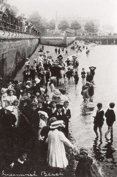 Old photograph of children enjoying Greenwich Beach below the walkway