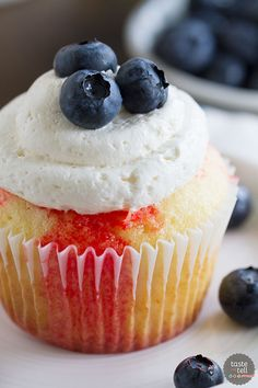 Cupcakes go patriotic with these Jello Poke Cupcakes that are streaked with red, then topped with white and blue. You can easily change the jello flavor and the topping for different holidays or flavors.: