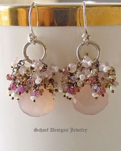 These sweet pale pink chalcedony tear drop briolettes are crowned with dozens of pastel colored sapphires and seed pearls and gracefully dangle from Sterling Silver French Wire Earrings. Stones are hand-wrapped in patinaed sterling silver for an