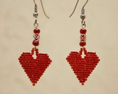 The beaded heart flag earrings are the perfect way to show your patriotic spirit. These earrings use the highest quality red, white, and blue glass seed beads and measure 3/4 wide.