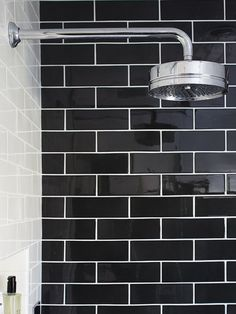 Try a 7-foot, floor-to-ceiling installation of black subway tile. The tile shape is not typical, it is 3 x 9 rather than the 3 x 6 norm. It puts a small modern touch on classic design. The shape ...