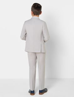 Need an outfit to set him apart from the crowd? The Jackson four-piece outfit is cut in a slim fit, featuring jacket and trousers in modern stone hue. Designed by Paisley of London, the Jackson exudes effortless cool, keeping him up to date with the latest suiting trends. Available from £59.99!  #suit #boyssuit #wedding #weddinginspo #stone #stonesuit #boysclothing #pageboy #groomsman #ringbearer #ringboy Ring Boy, Pageboy, Boys Suits, Chivalry, Groomsmen, Christening, Hue, Crowd, Back To School
