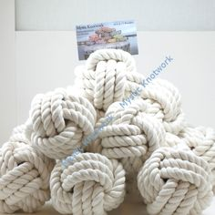 or have them bring alone a picture and put it in the middle of the table? i love it Nautical Wedding Table Number Holders
