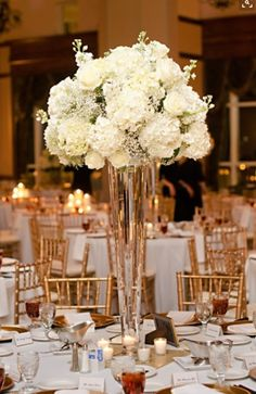 Take a look at the best white wedding flowers centerpieces in the photos below and get ideas for your wedding flowers! White Hydrangeas, roses, babies Breathe Tall Floral Arrangements for Weddings Image source Tall Floral Arrangements, Wedding Flower Arrangements, Tall Wedding Centerpieces, Reception Decorations, Centerpiece Ideas, White Floral Centerpieces, Hydrangea Centerpieces, Tall Vases For Wedding, Flower Centrepieces