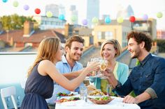 image #00af8k15 Group Of Friends Eating Meal On Rooftop Terrace #photo #image #repas #amitie #groupe