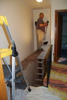 DIY scaffolding for painting tall walls in a stairwell...this is what we're going to have to do if we ever get the balls to paint this area of our house!