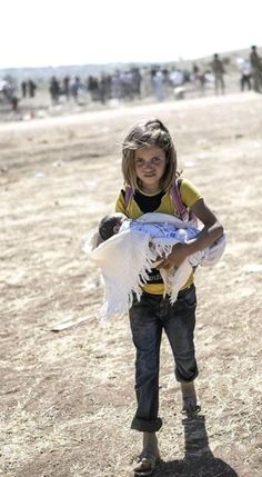 Kurdish Refugee Girl flees with her little Sibling from Syria.