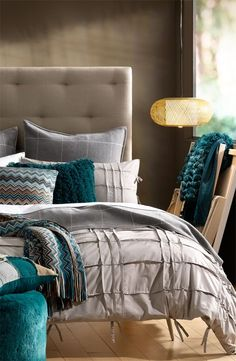 Turquoise and Grey Bedroom--a little too much pattern, but like the two colors together