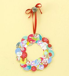 Love this idea! I have such a hard time deciding what to do with all the holiday cards that come every year and it takes a lot for me to toss them... Instead, cut circles from the cards and make a wreath.