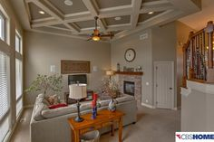 Traditional Living Room with stone fireplace, Reclaimed Timber Mantle, Ethan Allen Bennett Roll-Arm Sectional, Ceiling fan