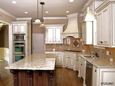 """Download the royalty-free photo """"Luxury Kitchen with Granite topped Island  2"""" created by aberenyi at the lowest price on Fotolia.com. Browse our cheap image bank online to find the perfect stock photo for your marketing projects!"""